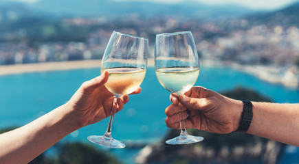 Drink two glasses white wine sea nature holidays, closeup romantic couple toast with alcohol, happy people cheering fun vacation enjoying travel time together friendship love concept congratulations