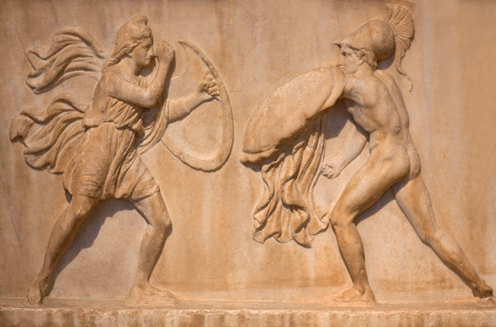Ancient Greek bas-relief - Amazon with full military equipment fighting a Greek warrior. Athens, Greece