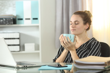 Entrepreneur resting drinking coffee at homeoffice