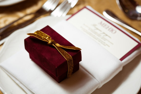 Wedding favor in an elegant gift box. Table setting. Shallow dof