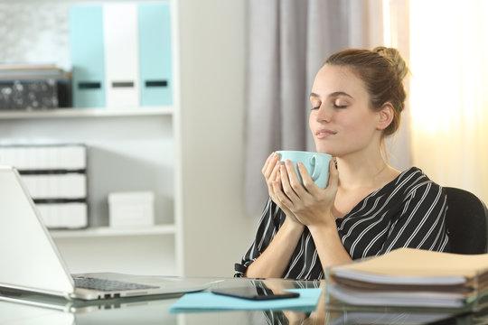 Entrepreneur resting drinking coffee at homeoffice
