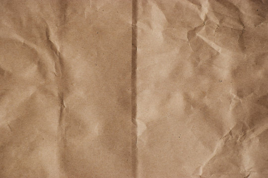Rough crumpled manilla brown paper background