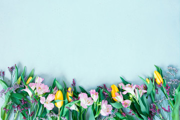 Keuken foto achterwand Tulp Blue background with spring flowers, festive composition for spring holidays