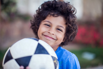 Smiling kid boy holding ball outdoor. Children, sport and activity concept