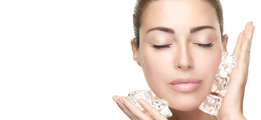 Spa Face Woman applies ice cubes on face. Healthy clean skin. Cold Beauty Treatments