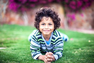 A portrait of smiling kid boy outdoor. Children and emotions concept