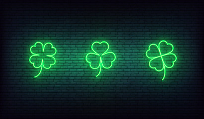 Clover neon icons. Set of green Irish shamrock icons for Saint Patrick's Day Wall mural