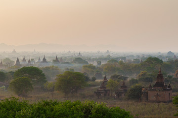 Scenic view of many temples and pagodas at the ancient plain of Bagan in Myanmar (Burma) in mist in the morning. Copy space.