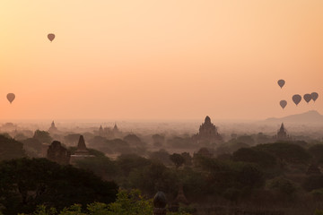 Beautiful view of hot-air balloons over temples and pagodas at the ancient plain of Bagan in Myanmar (Burma) at sunrise. Copy space.