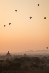 Beautiful view of hot-air balloons over temples and pagodas at the ancient plain of Bagan in Myanmar (Burma) at sunrise.