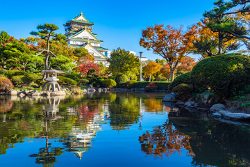 Japan. Osaka. Samurai fortress. The castle is reflected in the water. Ancient Japanese castle. Pond in front of the Japanese-style building. Travel to Japan. Autumn in Japan. Japanese castles. Wall mural