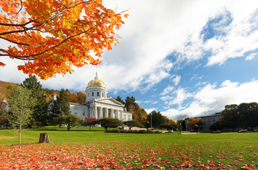The Vermont State House with Colorful Foliage in Background.  Located in Montpelier, the house is the state capitol of Vermont, in the United States.