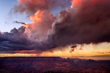 Dramatic storm clouds over the Grand Canyon at sunset in Grand Canyon National Park, Arizona, USA