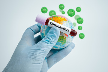 Scientist holding blood sample in test tube and globe in hand. Group of virus cells around test tube. Epidemic Mers-CoV Coronavirus researching and treatment concept.