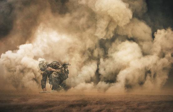 Military soldier making contact with Command Center between smoke in battle field