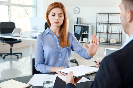 Bank manager working with displeased woman in office