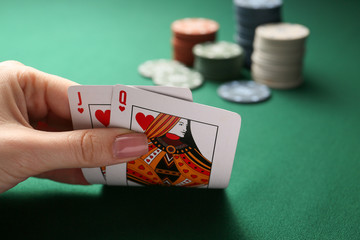 Woman playing poker in casino, closeup