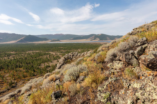 A view from the mountains to the big Terkhiin Tsagaan Lake or white lake in the Khangai Mountains in central Mongolia. The Khorgo volcano is located near the eastern end of the lake.