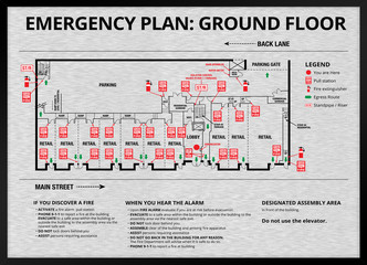 Emergency plan or egress plan. Brushed metal. Map of residential / strata building with retail stores and parking on ground floor. Detailed text instruction for residents in case of an emergency.