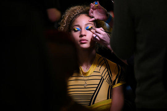 Models get hair and makeup done backstage at the Chromat Fall/Winter 2020 collection during fashion week in New York.