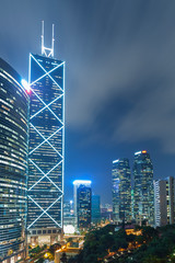 Fototapete - office building at night in hong kong city at night