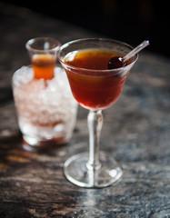 Whiskey cocktail with brandied cherry garnish