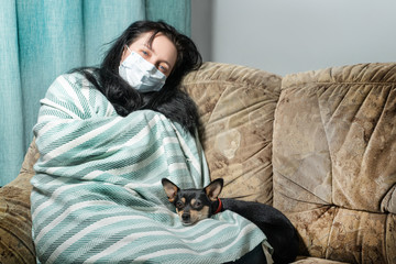 Sick young woman in bed at home having flu