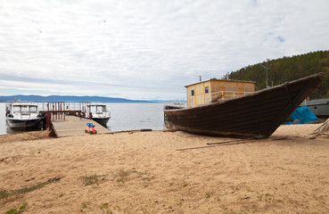 Lake Baikal. Ship quay on the shore of the Chivyrkuy Bay in the fishing village of Kurbulik