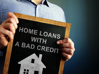 Home loans with bad credit written on a blackboard.