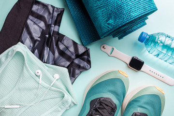 Healthy lifestyle, sport or athlete's equipment set on bright background. Flat lay. Top view with copy space.
