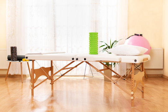 Interior of a massage or physical therapy treatment room with examination table.