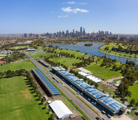 Melbourne Australia February 4th 2020 : Aerial view of buildings on the Albert Park F1 Grand Prix circuit with the lake and city of Melbourne in the background