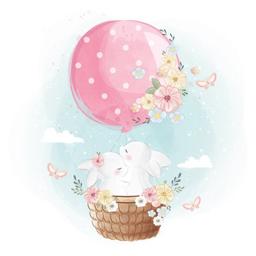 Bunny Couple Flying with a Balloon