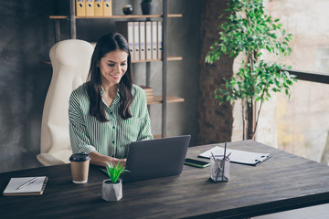 Portrait of her she nice-looking attractive cheerful focused content successful businesslady freelancer creating new design order client modern industrial brick loft interior style work place station