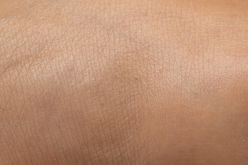Macro of human skin textuew, an extreme close up of foot skin of a young woman