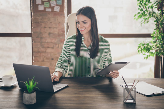 Portrait of her she nice attractive intelligent confident cheerful lady successful shark expert IT researcher ceo boss chief at modern industrial brick loft interior style work place station
