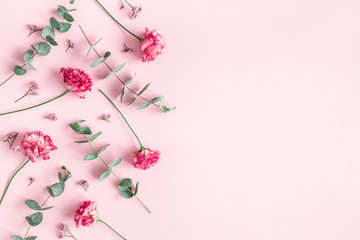Deurstickers Bloemen Flowers composition. Pink flowers and eucalyptus branches on pink background. Valentines day, mothers day, womens day concept. Flat lay, top view