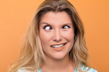 young latin woman looking goofy and funny with a silly cross-eyed expression, joking and fooling around