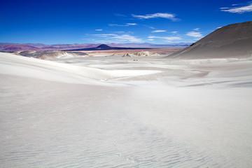 White dune at the lava field of the volcano Caraci Pampa at the Puna de Atacama, Argentina