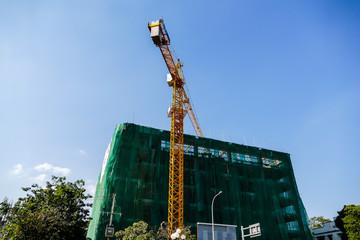 crane on construction site, digital photo picture as a background , taken in Patuxai laos, asia , taken in Sisaket temple , luang prabang, laos, asia