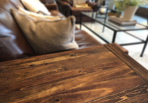 Empty weathered or vintage wooden table corner in living room of the background