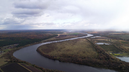 Bend of a wide river. Autumn landscape aerial view