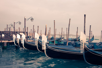 Wall Mural - Gondolas and wooden pier in winter in Venice, Italy