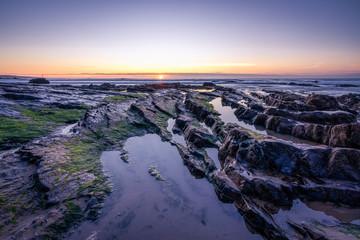 crooklets beach at sunset north cornwall uk