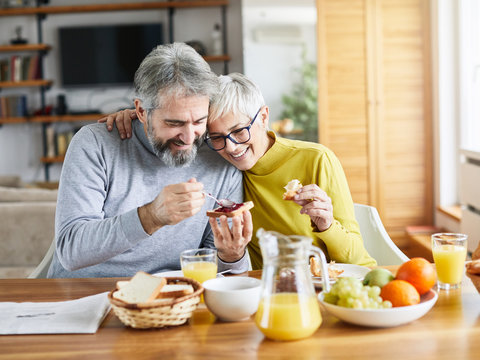 senior couple breakfast home food lifestyle eating table