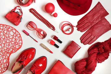 A collection of clothing items and accessories in one stylish trendy red color on a white background.
