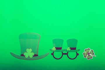 Different photo booth props for St Patricks Day party, top view, green background