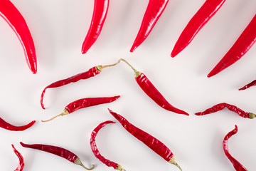 Hot, red chili peppers on white background