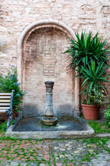 Italian public water fountain in a small village of Italy