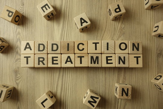 Text addiction treatment from wooden blocks
